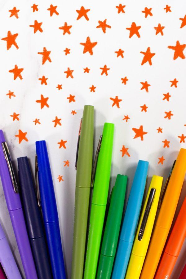 Colorful Rainbow Pens with stars around them